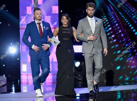 Josh Donaldson, from left, Gina Rodriguez, and Bryce Harper present the best female athlete award at the ESPY Awards at the Microsoft Theater, in Los Angeles