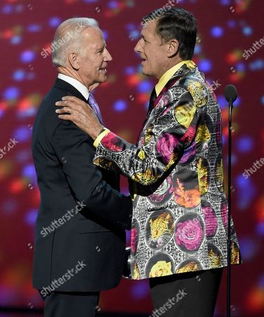 Vice President Joe Biden, left, presents Craig Sager the Jimmy V award for perseverance at the ESPY Awards at the Microsoft Theater, in Los Angeles