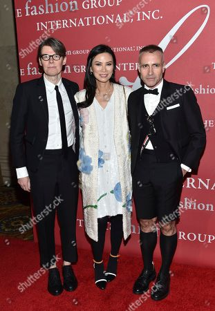 Lord & Taylor Fashion Oracle Award recipient Andrew Bolton, left, Wendi Murdoch and designer Thom Browne attend The Fashion Group International's Night of Stars Gala at Cipriani Wall Street, in New York