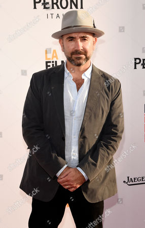 """Ricardo de Montreuil, director of """"Lowriders,"""" poses at the premiere of the film on the opening night of the Los Angeles Film Festival at the Arclight Hollywood, in Los Angeles"""