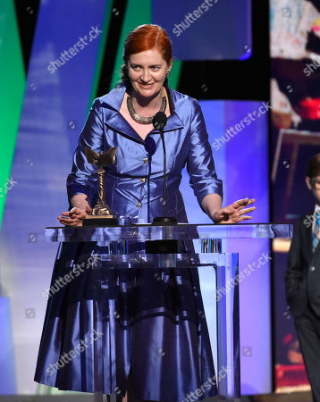 """Emma Donoghue accepts the award for best screenplay for """"Room"""" at the Film Independent Spirit Awards, in Santa Monica, Calif"""