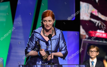 """Stock Picture of Emma Donoghue accepts the award for best screenplay for """"Room"""" at the Film Independent Spirit Awards, in Santa Monica, Calif"""