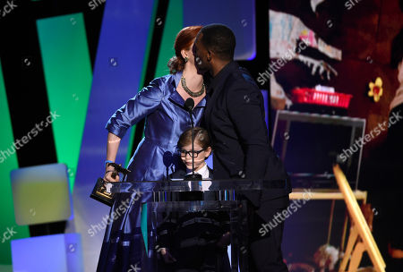 """Jacob Tremblay, center, and Anthony Mackie, right, present the award for best first screenplay to Emma Donoghue for """"Room"""" at the Film Independent Spirit Awards, in Santa Monica, Calif"""