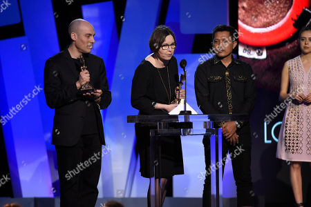 Joshua Oppenheimer, left, and Signe Byrge Sorensen accept the award for best documentary for The Look of Silence at the Film Independent Spirit Awards, in Santa Monica, Calif