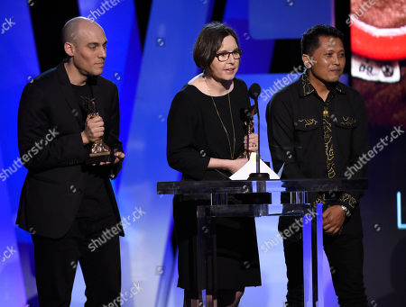 Stock Photo of Joshua Oppenheimer, left, and Signe Byrge Sorensen accept the award for best documentary for The Look of Silence at the Film Independent Spirit Awards, in Santa Monica, Calif