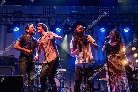Scott Avett, from left, Seth Avett, Joe Kwon, and Tania Elizabeth of The Avett Brothers seen on day one of Forecastle Music Festival at Waterfront Park, in Louisville, Ky