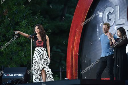 Actress Priyanka Chopra, left, musician Chris Martin and Member of Parliament from Mumbai North Central Poonam Mahajan speak at the 2016 Global Citizen Festival in Central Park, in New York