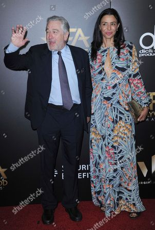 Robert De Niro, left, and his daughter Drena De Niro arrive at the 20th annual Hollywood Film Awards at the Beverly Hilton Hotel, in Beverly Hills, Calif