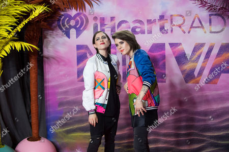 Sara Keirsten Quin and Tegan Rain Quin of Tegan and Sara pose in the press room at the 2016 iHeartRadio MuchMusic Video Awards, in Toronto, Canada