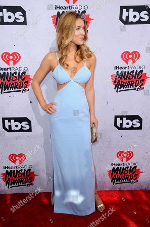 Nathalia Ramos arrives at the iHeartRadio Music Awards at The Forum, in Inglewood, Calif