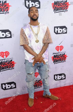 Omarion arrives at the iHeartRadio Music Awards at The Forum, in Inglewood, Calif