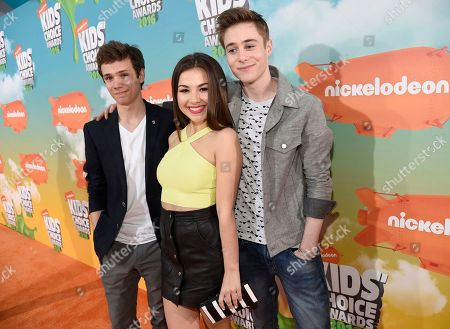 Taylor Adams, from left, Esther Zyskind and Callan Potter arrive at the Kids' Choice Awards at The Forum, in Inglewood, Calif