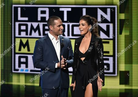 Stock Picture of Michel Brown, left, and Patricia Manterola present the award for favorite urban band/duo/group at the Latin American Music Awards at the Dolby Theatre, in Los Angeles