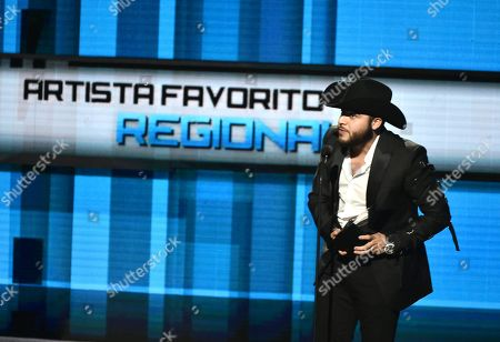 Gerardo Ortiz accepts the award for favorite regional mexican artist at the Latin American Music Awards at the Dolby Theatre, in Los Angeles
