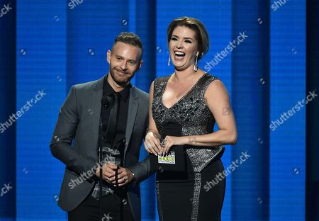 Luis Ernesto Franco, left, and Alicia Machado present the award for favorite pop/rock female artist at the Latin American Music Awards at the Dolby Theatre, in Los Angeles