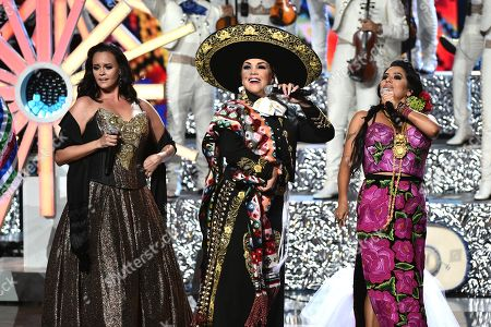 Shaila Durcal, from left, Aida Cuevas and Lila Downs perform a tribute to Juan Gabriel at the Latin American Music Awards at the Dolby Theatre, in Los Angeles