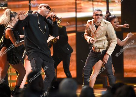 Alexander Delgado, left, and Randy Malcom Martinez, of Gente de Zona, perform at the 17th annual Latin Grammy Awards at the T-Mobile Arena, in Las Vegas