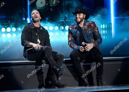 """Prince Royce, left, and Gerardo Ortiz perform """"Moneda""""at the 17th annual Latin Grammy Awards at the T-Mobile Arena, in Las Vegas"""