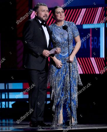 Poncho Lizarraga and Nina Pastori present the award for best rock album at the 17th annual Latin Grammy Awards at the T-Mobile Arena, in Las Vegas