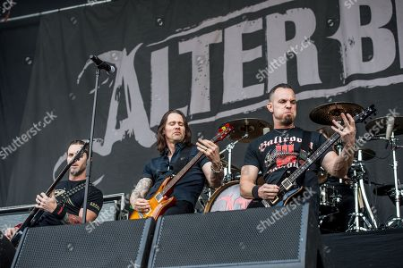 Brian Marshall, from left, Myles Kennedy, and Mark Tremonti of Alter Bridge perform at the Louder Than Life Festival, in Louisville, Ky