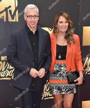 Drew Pinsky, left, and Susan Pinsky arrive at the MTV Movie Awards at Warner Bros. Studios, in Burbank, Calif