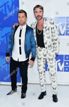 Lance Bass, left, and Robert Sepulveda Jr. arrive at the MTV Video Music Awards at Madison Square Garden, in New York