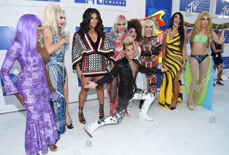 Stock Photo of Frankie J. Grande, center, poses with Coco Montrese, from left, Alyssa Edwards, Roxxxy Andrews, Phi Phi O'hara, Ginger Minj, Katya, Detox, Tatianna, and Alaska, of RuPaul's Drag Race All Stars at the MTV Video Music Awards at Madison Square Garden, in New York