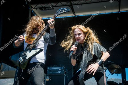 Ian Alden, left, and Jill Janus of Huntress performs during night one of Ozzfest meets Knotfest at San Manuel Amphitheater, in San Bernardino, Calif