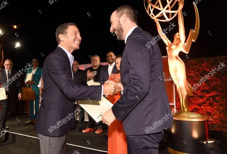 Bruce Rosenblum Chairman and CEO, the Television Academy, left, congratulates Mark Ivanir at the Performers Nominee Reception presented by the Television Academy at the Pacific Design Center, in West Hollywood, Calif
