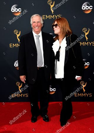 Henry Winkler, left, and Stacey Weitzman arrive at the 68th Primetime Emmy Awards, at the Microsoft Theater in Los Angeles