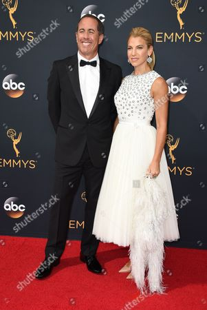 Jerry Seinfeld, left, and Jessica Seinfield arrive at the 68th Primetime Emmy Awards, at the Microsoft Theater in Los Angeles