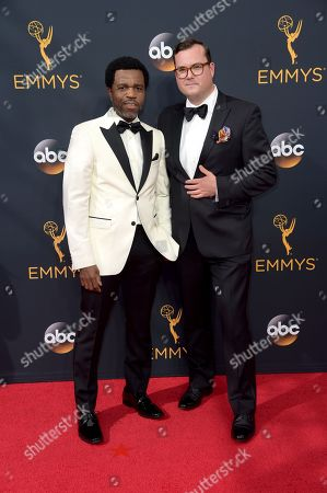 Kevin Hanchard, left, and Kristian Bruun arrive at the 68th Primetime Emmy Awards, at the Microsoft Theater in Los Angeles