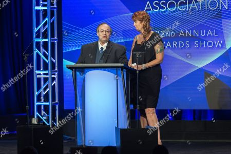 Eric Deggans, left, and Kristi Turnquist present the award for Outstanding Achievement in Movies, Miniseries and Specials at the 32nd Annual Television Critics Association Awards Show at the Beverly Hilton, in Beverly Hills, Calif