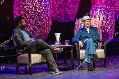 Baratunde Thurston, left, and Norman Lear speak on board the Norwegian Escape during day 1 of the Summit at Sea cruise on in Miami