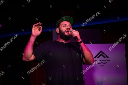 Comedian Mo Amer performs on board the Norwegian Escape during day 1 of the Summit at Sea cruise on in Miami