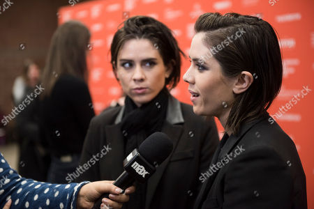"""Musicians Tegan Rain Quin, left, and Sara Keirsten Quin of Tegan and Sara speak during an interview at the premiere of """"The Intervention"""" during the 2016 Sundance Film Festival, in Park City, Utah"""