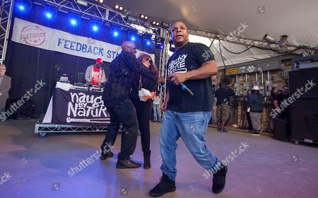 DJ Kay Gee and Treach of Naughty by Nature with Rachael Ray and Vin Rock of Naughty by Nature perform at Rachael Ray's Feedback Party at Stubb's Bar-B-Que, during the South by Southwest Music Festival, in Austin, Texas