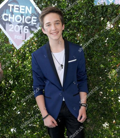 Michael Campion arrives at the Teen Choice Awards at the Forum, in Inglewood, Calif