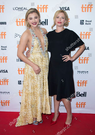 """Chloe Grace Moretz, left, and Susannah Cahalan attend the premiere for """"Brain on Fire"""" on day 9 of the Toronto International Film Festival at the Princess of Wales Theatre, in Toronto"""