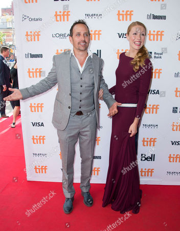 "Robert Moloney, left, and Julie Lynn Mortensen attend the premiere for ""Brain on Fire"" on day 9 of the Toronto International Film Festival at the Princess of Wales Theatre, in Toronto"