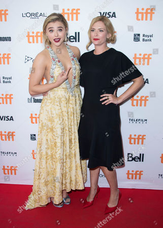"""Chloë Grace Moretz, left, and Susannah Cahalan attend the premiere for """"Brain on Fire"""" on day 9 of the Toronto International Film Festival at the Princess of Wales Theatre, in Toronto"""