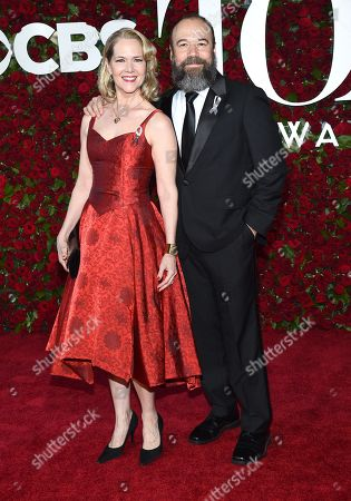 Danny Burstein, left, and Rebecca Luker arrive at the Tony Awards at the Beacon Theatre, in New York