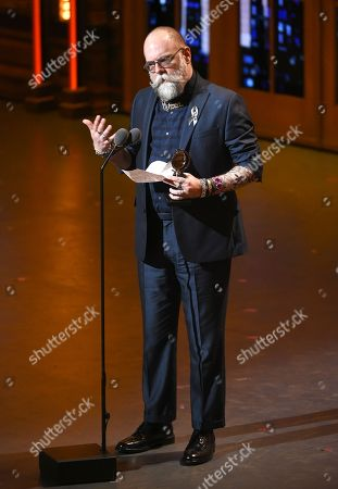 """David Zinn holds the award for best scenic design of a play for """"The Humans,"""" at the Tony Awards at the Beacon Theatre, in New York"""
