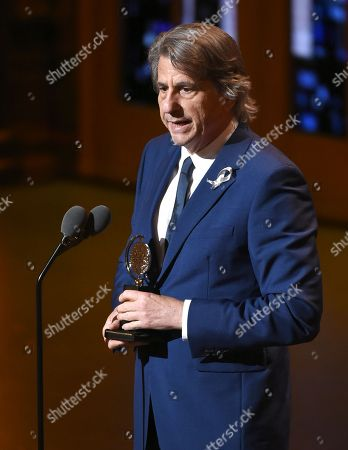 "David Rockwell accepts the award for best scenic design for the musical ""She Loves Me"" at the Tony Awards at the Beacon Theatre, in New York"