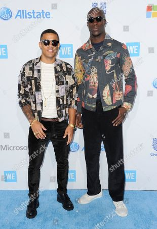Nico Sereba, left, and Vinz Dery arrive at WE Day California at the Forum, in Inglewood, Calif
