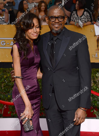 Keisha Nash Whitaker and Forest Whitaker arrive at the 20th annual Screen Actors Guild Awards at the Shrine Auditorium, in Los Angeles