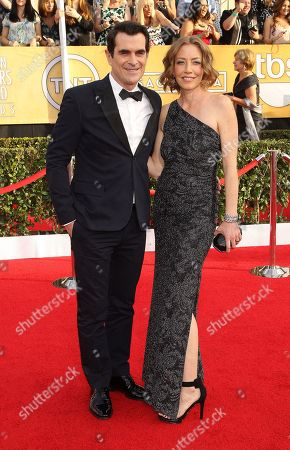 Ty Burrell and Holly Anne Brown arrives at the 20th annual Screen Actors Guild Awards at the Shrine Auditorium, in Los Angeles