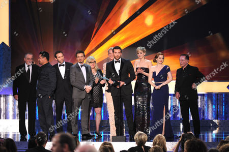 From left, Robert De Niro, Michael Pena, Alessandro Nivola, Jeremy Renner, Colleen Camp, Elisabeth Rohm, Bradley Cooper, Jennifer Lawrence, Amy Adams and Paul Herman accept the award for outstanding performance by a cast in a motion picture for American Hustle at the 20th annual Screen Actors Guild Awards at the Shrine Auditorium, in Los Angeles