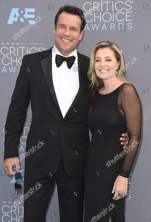 David James Elliott, left, and Nanci Chambers arrive at the 21st annual Critics' Choice Awards at the Barker Hangar, in Santa Monica, Calif