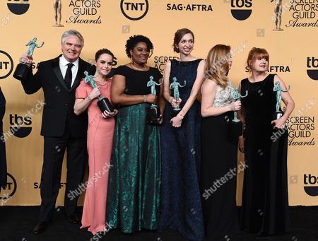 Yvette Freeman, from left, Michael J. Harney, Taryn Manning, Adrienne C. Moore, Lauren Lapkus, Natasha Lyonne and Annie Golden pose in the press room with the award for outstanding ensemble in a comedy series for Orange is the New Black at the 21st annual Screen Actors Guild Awards at the Shrine Auditorium, in Los Angeles